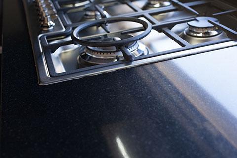 kitchen stove and black granite